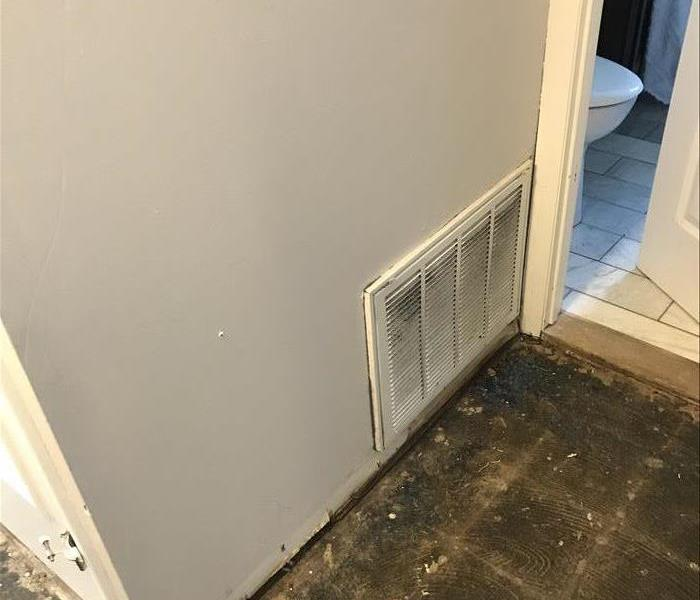 wall with heating vent damaged by water