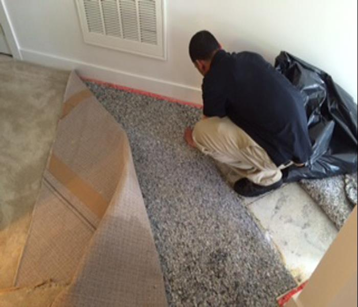 pulling up wet carpet in a room that was flooded