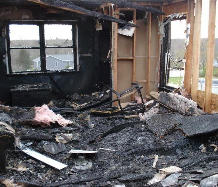 room in a home that suffered a fire completely demolished.
