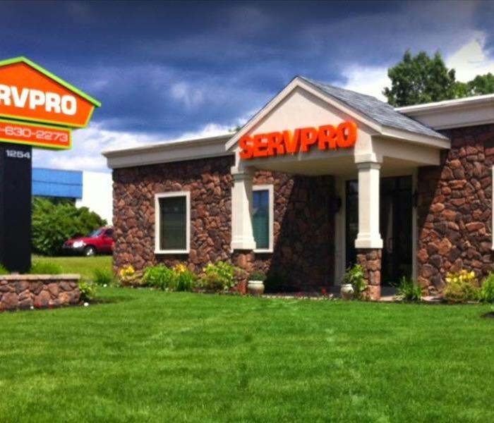 Front of SERVPRO of Meriden building and grass lawn, with SERVPRO sign on the left