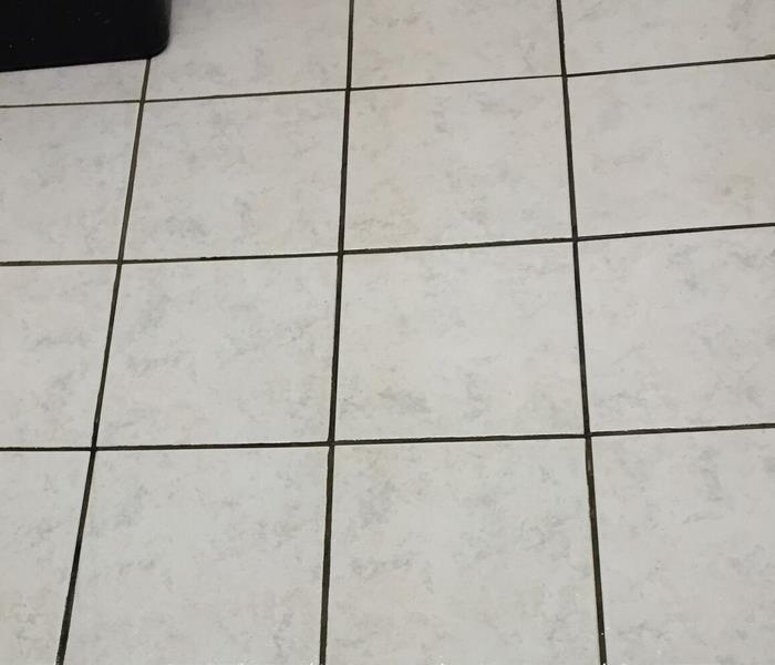 clean tile floor after cleanup of biohazard