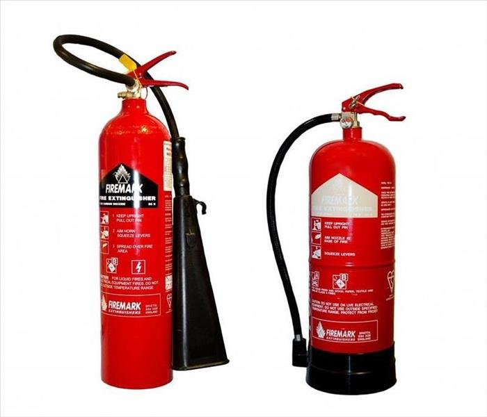 2 different red fire extinguishers side by side