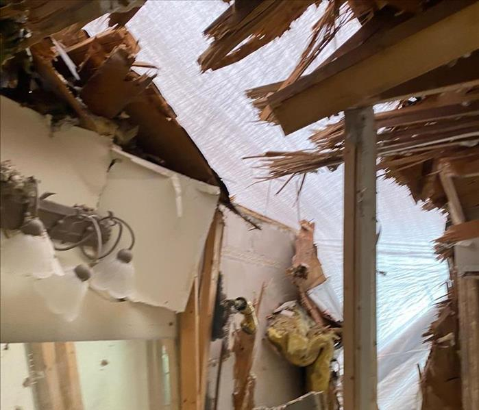 extreme damage from tornado demolishes bathroom because tree fell on home