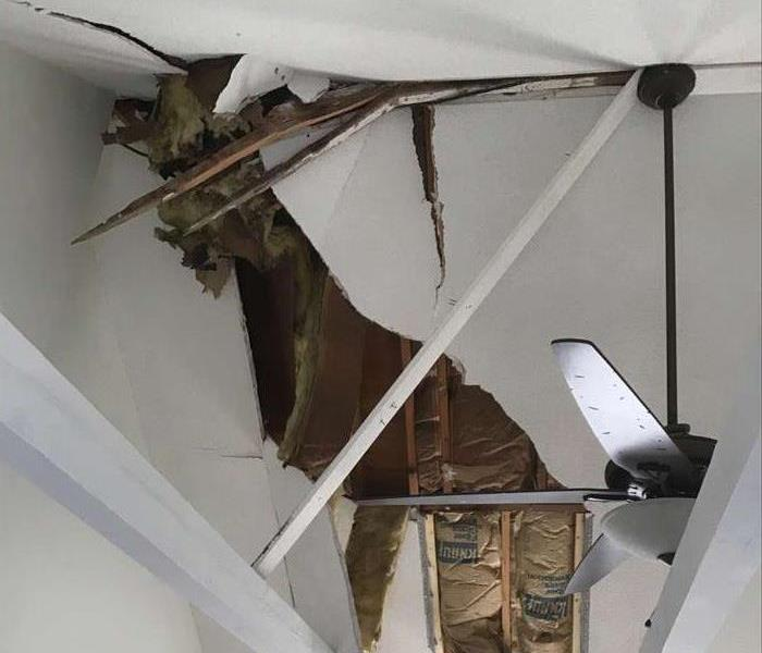 a large branch went through the roof after a bad storm and heavy rains