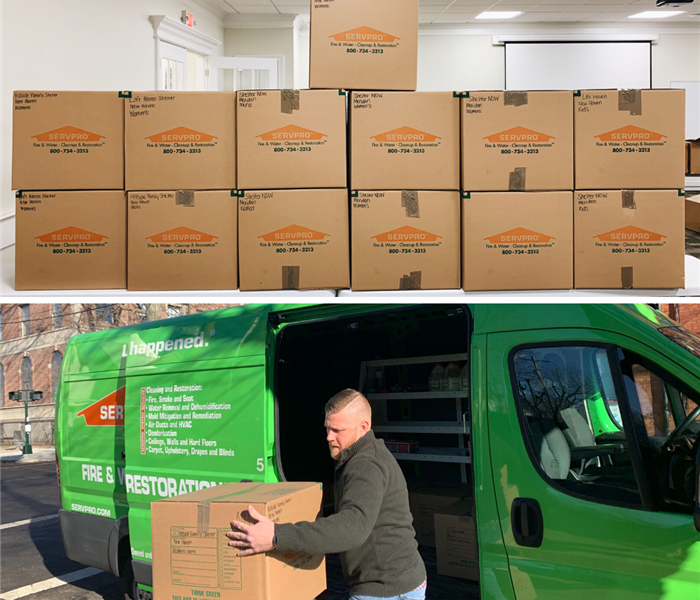 boxes of donations for local shelters; servpro marketer unloading servpro van to drop off donations