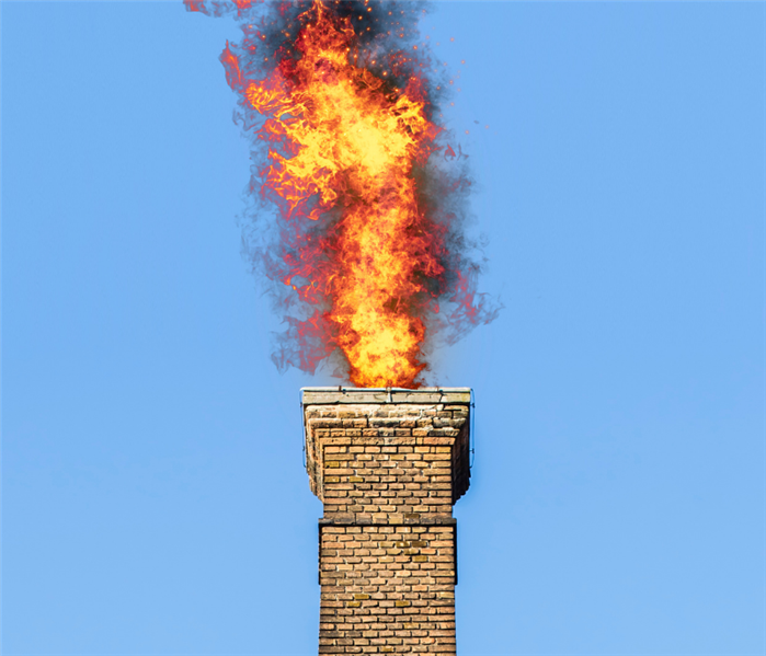 fire shooting out of chimney from creosote lighting on fire